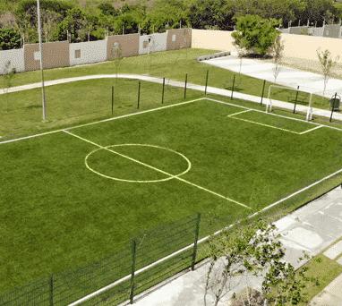 Cancha de fútbol de pasto sintético en Escobedo